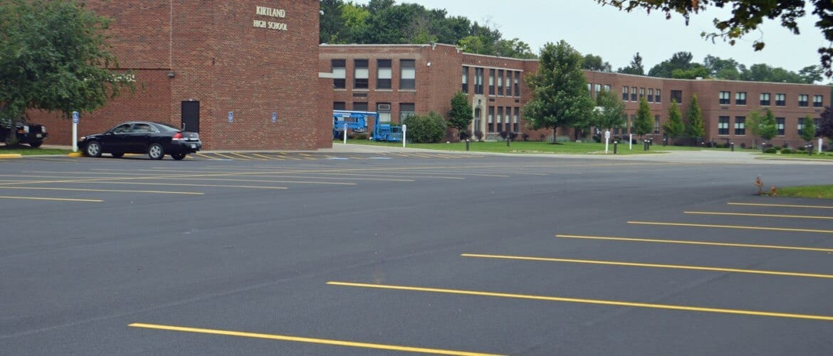 Finished Kirtland High School parking lot paving, sealcoating and line striping.
